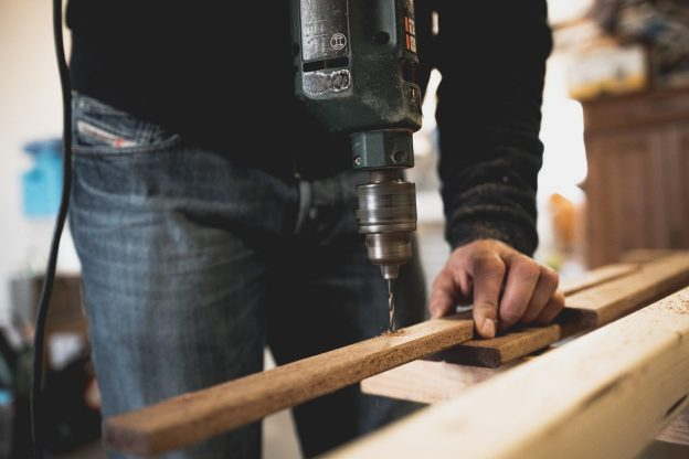 Drilling Wood in a window shop